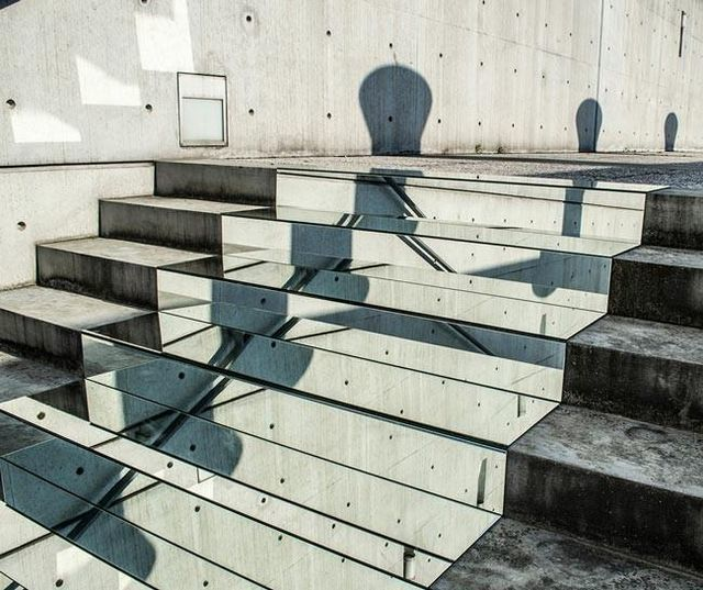 Mirrors-installed-on-stairs-make-it-appear-you're-walking-amongst-the-clouds4-650x545